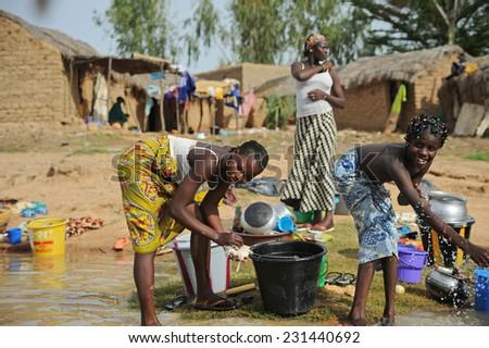 MOPTI, MALI, AFRICA - SEPTEMBER, 3, 2011 women washing in the river - stock photo