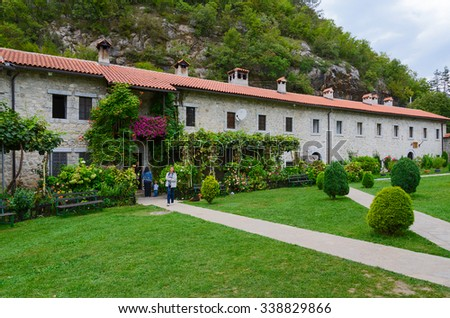 MORACA VALLEY, MONTENEGRO - SEPTEMBER 20, 2015: Unidentified tourists visit Moraca Monastery, which is one of most significant Serbian medieval Orthodox monuments in Balkans - stock photo