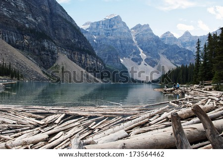 Moraine Lake, a glacially-fed lake in Banff National Park, Alberta, Canada, situated in the Valley of the Ten Peaks. Surrounded by the snow covered peaks of the Rocky Mountains. - stock photo