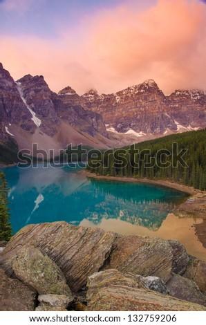 Moraine Lake on a beautiful pink morning - stock photo