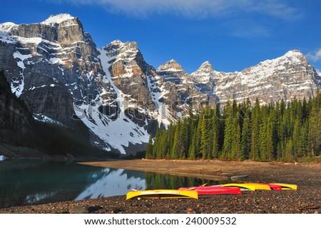 Moraine Lake Shore Canoes - Banff National Park, Canadian Rockies, Alberta, Canada - stock photo