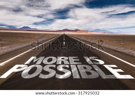 More is Possible written on desert road - stock photo