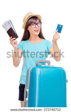 More opportunities! Travel concept. Studio portrait of pretty young woman holding passport and banking card. Isolated on white - stock photo