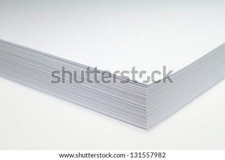 More than 200 new white sheets of paper over one another. - stock photo