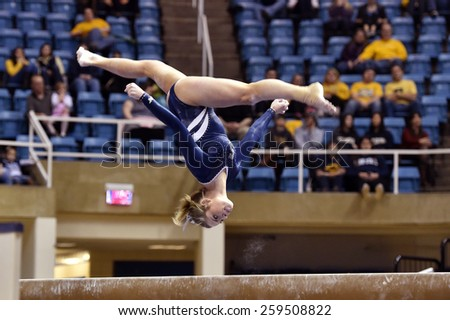 MORGANTOWN, WV - MARCH 8: Penn State female gymnast Emma Sibson performs on the balance beam during a dual meet March 8, 2015 in Morgantown, WV.  - stock photo
