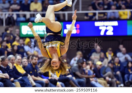 MORGANTOWN, WV - MARCH 7: The West Virginia cheerleaders perform during the Big 12 Conference college basketball game March 7, 2015 in Morgantown, WV.  - stock photo