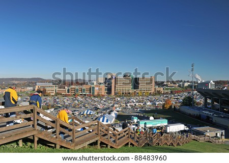 """MORGANTOWN, WV - NOVEMBER 5: Fans stream down the stairs from """"Law School Hill"""" at Mountaineer Field heading to the football game between WVU and Louisville November 5, 2011 in Morgantown, WV - stock photo"""