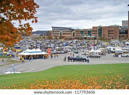MORGANTOWN, WV - NOVEMBER 3: Fans tailgate in a parking lot just outside Mountaineer Field prior to a WVU home football game November 3, 2012 in Morgantown, WV. - stock photo
