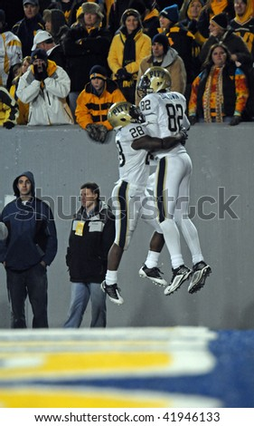 MORGANTOWN, WV - NOVEMBER 27: Pitt wide receiver Jonathan Baldwin (#82) clebrates with Dion Lewis (#28) after Baldwin's TD catch November 27, 2009 in Morgantown, WV. - stock photo