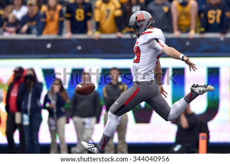 MORGANTOWN, WV - NOVEMBER 7: Texas Tech Red Raiders place kicker Michael Barden (49) punts the ball during the NCAA football game November 7, 2015 in Morgantown, WV.  - stock photo