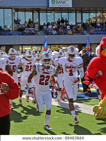 MORGANTOWN, WV - NOVEMBER 5: The Louisville Cardinals football team takes the field prior to the football game between WVU and Louisville November 5, 2011 in Morgantown, WV - stock photo