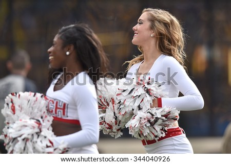 MORGANTOWN, WV - NOVEMBER 7: The Texas Tech Red Raiders cheerleaders perform during the NCAA football game November 7, 2015 in Morgantown, WV.  - stock photo