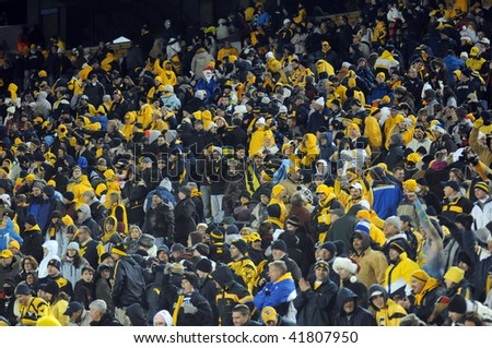 MORGANTOWN, WV - NOVEMBER 27: West Virginia University football fans celebrate in the stands following WVU's upset 16-13 win over Pitt November 27, 2009 in Morgantown, WV. - stock photo