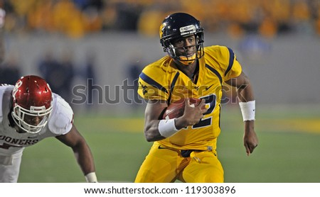 MORGANTOWN, WV - NOVEMBER 17: WVU quarterback Geno Smith (12) runs in the open field during the Big 12 conference game between the Mountaineers and Sooners November 17, 2012 in Morgantown, WV