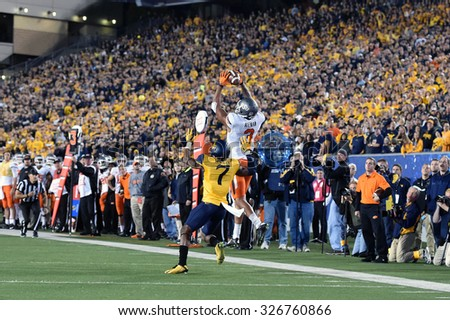 MORGANTOWN, WV - OCTOBER 10: Oklahoma State Cowboys wide receiver Marcell Ateman (3) goes up for a catch during the Big 12 football game October 10, 2015 in Morgantown, WV.  - stock photo