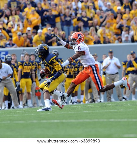 MORGANTOWN, WV - OCTOBER 23: Syracuse defensive back Da'Mon Merkerson (#6) prepares to make a tackle against a WVU receiver late in a game October 23, 2010 in Morgantown, WV. - stock photo