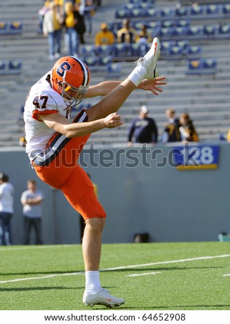 MORGANTOWN, WV - OCTOBER 23: Syracuse punter Ryan Long follows through on a punt during pregame drills October 23, 2010 in Morgantown, WV. - stock photo