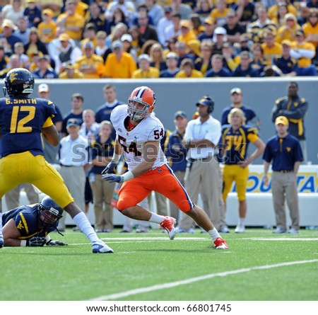 MORGANTOWN, WV - OCTOBER 23: Syracuse University linebacker Mikhail Marinovich (#54) turns the corner on a pass rush in a Big East game October 23, 2010 in Morgantown, WV.