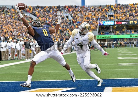 MORGANTOWN, WV - OCTOBER 18: West Virginia Mountaineers wide receiver Kevin White (11) makes a spectacular catch for a touchdown during the Big 12 football game October 18, 2014 in Morgantown, WV.  - stock photo