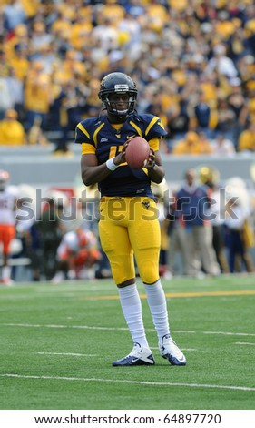 MORGANTOWN, WV - OCTOBER 23: West Virginia University quarterback Geno Smith warms up just prior to the football on October 23, 2010 in Morgantown, West Virginia. - stock photo