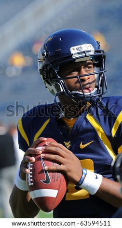 MORGANTOWN, WV - OCTOBER 23: West Virginia University quarterback Geno Smith warms up on the sideline prior to the game against Syracuse October 23, 2010 in Morgantown, WV. - stock photo