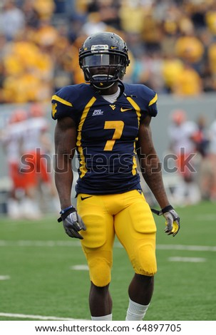 MORGANTOWN, WV - OCTOBER 23: West Virginia University running back Noel Devine warms up just prior to the football on October 23, 2010 in Morgantown, West Virginia. - stock photo