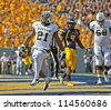 MORGANTOWN, WV - SEPTEMBER 29: Baylor Bears running back Jarred Salubi (21) scores a touchdown during a Big 12 conference football game September 29, 2012 in Morgantown, WV. - stock photo