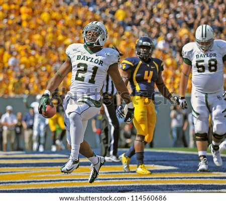 MORGANTOWN, WV - SEPTEMBER 29: Baylor Bears running back Jarred Salubi (21) scores a touchdown during a Big 12 conference football game September 29, 2012 in Morgantown, WV.