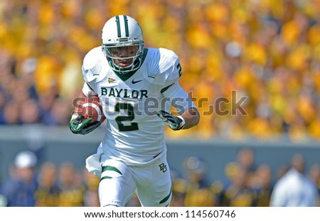 MORGANTOWN, WV - SEPTEMBER 29: Baylor Bears wide receiver Terrance Williams (2) runs with the ball after a catch during a Big 12 conference football game September 29, 2012 in Morgantown, WV. - stock photo