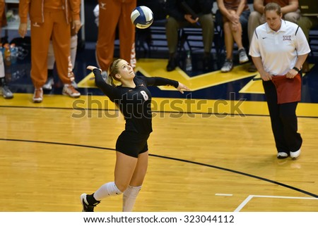 MORGANTOWN, WV - SEPTEMBER 25: Texas libero Cat McCoy (8) serves during a volleyball match  September 25, 2015 in Morgantown, WV.
