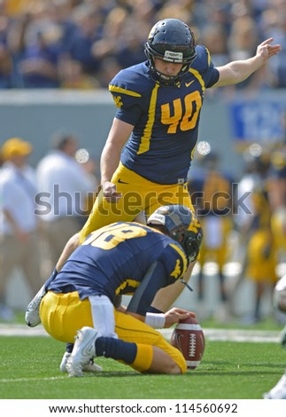 MORGANTOWN, WV - SEPTEMBER 29: West Virginia Mountaineers kicker Tyler Bitancurt (40) kicks an extra point during a Big 12 conference football game September 29, 2012 in Morgantown, WV. - stock photo