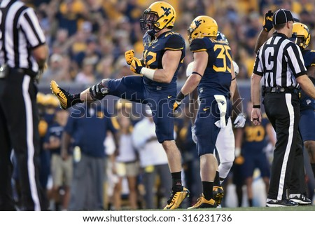 MORGANTOWN, WV - SEPTEMBER 5:  West Virginia Mountaineers linebacker Jared Barber (42) reacts to a big hit during the season opening game September 5, 2015 in Morgantown, WV.
