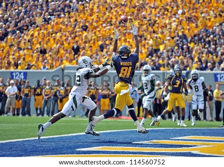 MORGANTOWN, WV - SEPTEMBER 29: West Virginia Mountaineers wide receiver J.D. Woods (81) goes up to make a touchdown catch during a Big 12 conference football game September 29, 2012 in Morgantown, WV. - stock photo