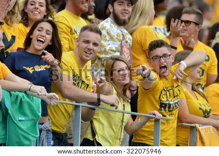 MORGANTOWN, WV - SEPTEMBER 26: WVU fans in the student section celebrate a touchdown during the NCAA football game September 26, 2015 in Morgantown, WV.  - stock photo