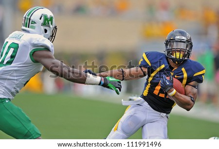 MORGANTOWN, WV - SEPTEMBER 1: WVU running back Andrew Buie (with ball) carries during the first football game of the season against Marshall September 1, 2012 in Morgantown, WV.