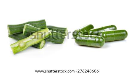 Moringa and capsule pills on white background - stock photo