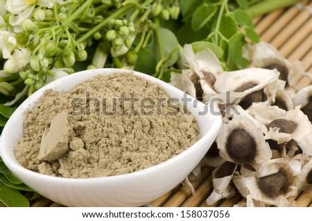 Moringa seed, moringa fresh leaves, flowers and moringa powder moringa (Moringa oleifera Lam.). - stock photo