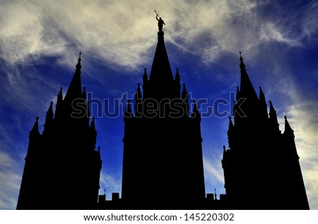 Mormon LDS Salt Lake City Temple Silhouette against Blue Cloudy Sky - stock photo