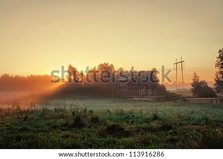 Morning at cottage in village at dawn. Residence for family and happiness - stock photo