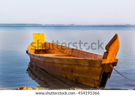 Morning at Lake Svityaz, Ukraine. Wooden boat stands near the shore.