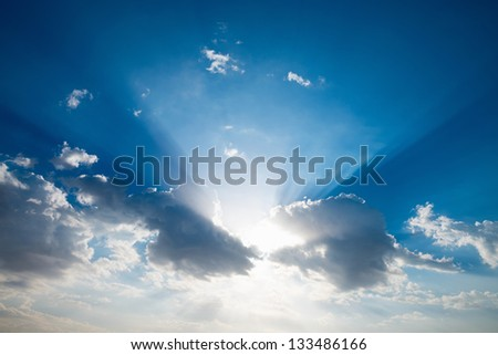 Morning blue sky with clouds and natural sun rays - stock photo