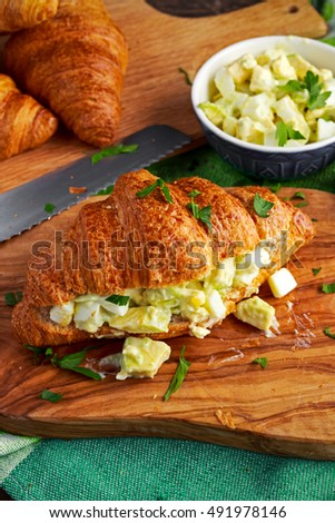 Morning Breakfast Croissant with avocado, egg salad