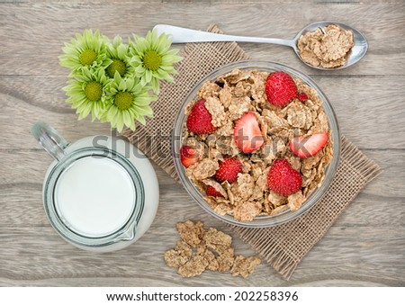 Morning breakfast with cornflakes and fresh strawberry - stock photo