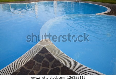 Morning by nice Italian swimming pool at summertime. - stock photo