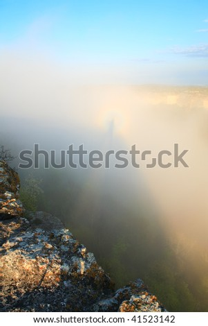 Morning cloudy view from top of Mangup Kale (historic fortress and ancient cave settlement in Crimea, Ukraine) and shadow on cloud with halo