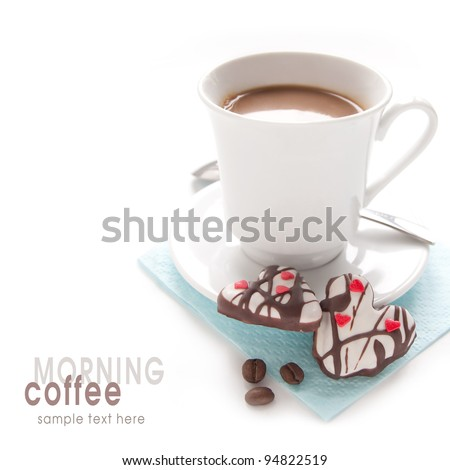 Morning coffee and biscuits in the shape of hearts on the white background - stock photo