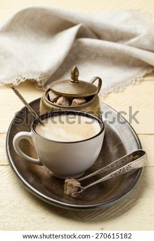 Morning coffee and sugar on a metal tray on the white wooden table - stock photo