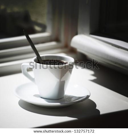 morning coffee on the window sill - stock photo