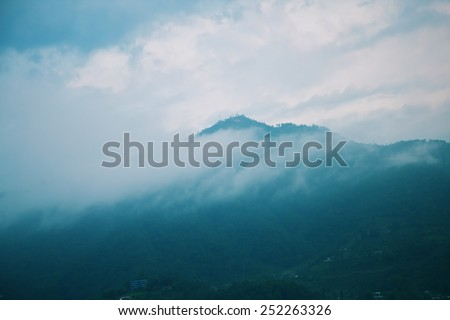Morning fog landscape with mountains and sky - stock photo
