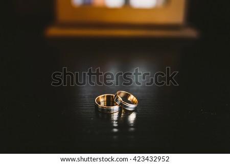 morning gathering of the bride. wedding rings on wedding decor - stock photo